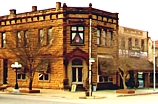 Decade-plus Year Old Bank Building, Now Pawnee Bill Trading Post. The Bank is still in business and celebrated its 130th year in 2004. Note the Lady in the upstairs window! She has many costume changes throughout the year!